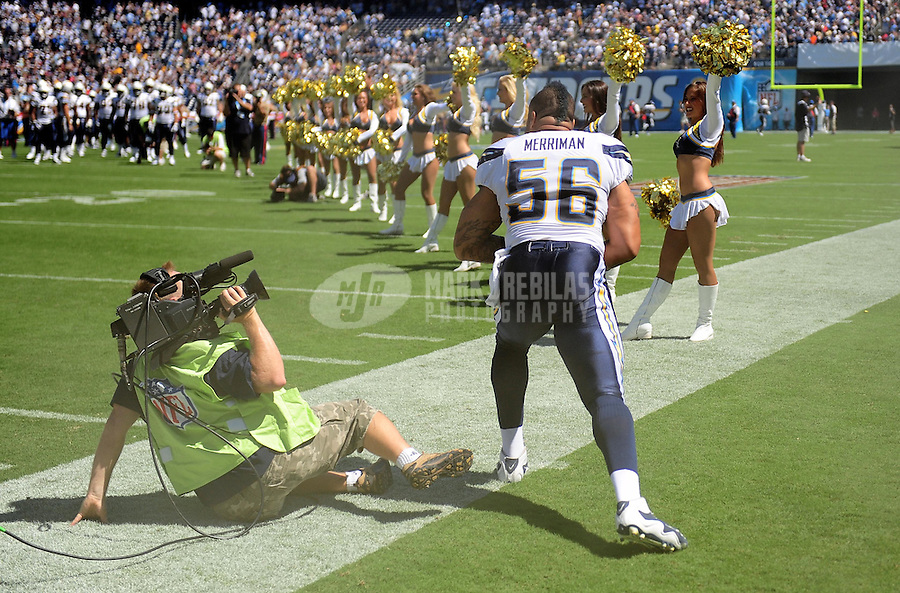 Sep. 20, 2009; San Diego, CA, USA; San Diego Chargers linebacker Shawne Merriman knocks over a cameraman prior to the game against the Baltimore Ravens at Qualcomm Stadium in San Diego. Baltimore defeated San Diego 31-26. Mandatory Credit: Mark J. Rebilas-