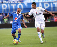BOGOTA -COLOMBIA. 03-05-2014. Mayer Candelo  (Izq) de Millonarios  disputa el balon contra Jerson Malagon de La Equidad  partido de vuelta por los Cuartos de Final  de La liga Postobon  disputado en el estadio Nemesio Camacho El Campin. /   Mayer Candelo  (L) of Millonarios dispute the balloon against Jerson Malagon of La Equidad  game around the Quarter Finals of the Postobon league match at the Estadio Nemesio Camacho El Campin. Photo: VizzorImage/ Felipe Caicedo / Staff