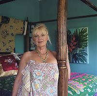 Portrait of the designer Miv Watts in her bedroom