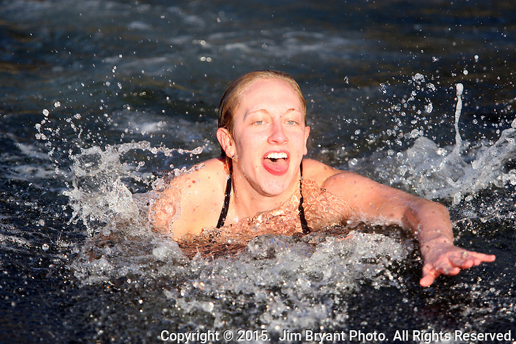 Heidi Edgecone swims towards the shore after jumping off the bridge into the Burley Lagoon during the 31st annual Polar Bear on January 1, 2015 in Olalla, Washington. Over 500 hardy participants joined in on the annual New Year's Day Tradition by jumping into the chilly lagoon waters during the annual Polar Bear Plunge.