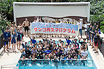 Volunteers participating in the Team Tyura Sango coral restoration project have a group photo taken by the ANA InterContinental Manza Beach Resort dive pool after planting coral on the seabed in the bay at Onna Village, Okinawa Prefecture, Japan, on  June 23, 2012. Photographer: Robert Gilhooly