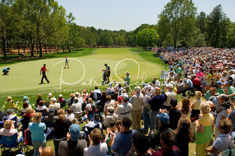 Crowds gather around a green to watch Tiger Woods play during the 2007 Wachovia Championships at Quail Hollow Country Club in Charlotte, NC.