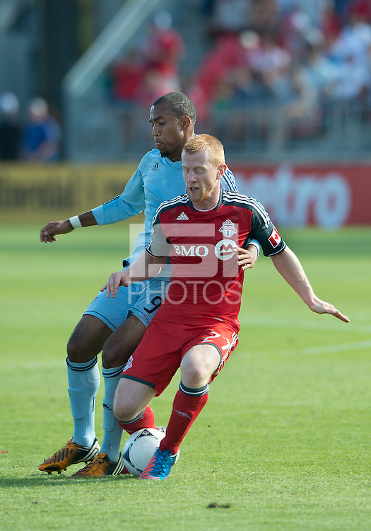 18 August 2012: Sporting KC forward Teal Bunbury #9 and Toronto FC defender Richard Eckersley #27 in action during an MLS game between Sporting Kansas City and Toronto FC at BMO Field in Toronto, Ontario Canada.