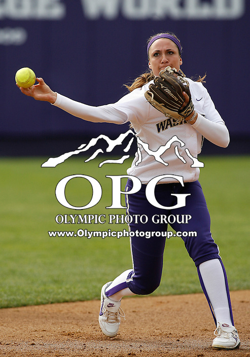 14 March 2010:  Washington Huskies #8 Maggie Wagner warms up before the game against Seattle University. Washington defeated Seattle University 8-3 at Husky Softball Stadium in Seattle, WA.