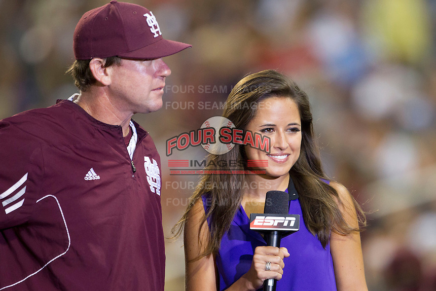 Mississippi State head coach John Cohen (11) is interviewed by ESPN reporter Kaylee Hartung during Game 1 of the 2013 Men's College World Series Finals against the UCLA Bruins on June 24, 2013 at TD Ameritrade Park in Omaha, Nebraska. The Bruins defeated the Bulldogs 3-1, taking a 1-0 lead in the best of 3 series. (Andrew Woolley/Four Seam Images)