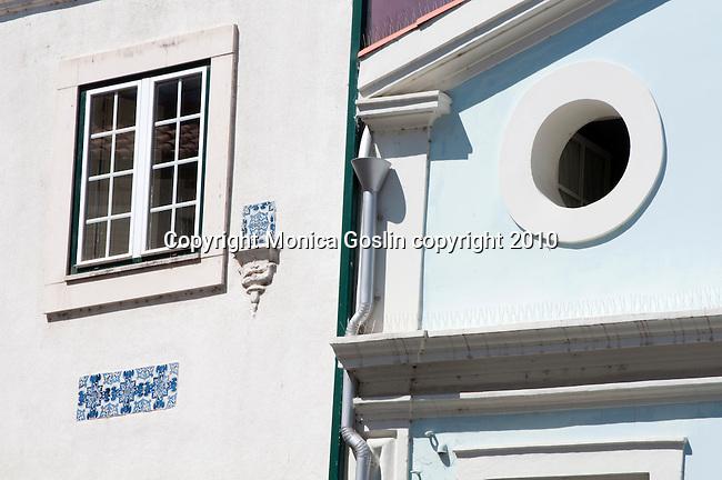 Two windows in Coimbra, Portugal.