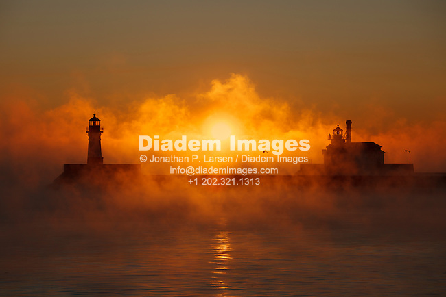 Duluth, Minnesota lighthouses at dawn on a bitterly cold January morning.