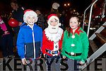 Enjoying the switching on of the christmas lights in Castleisland on Saturday were Anthony Galvin, Jonathan Galvin, Sinead Galvin