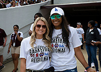 Women's basketball players Blair Schaefer and Victoria Vivians pose for a photo before being honored during halftime at the Maroon and White football game. <br />  (photo by Lizzy Powers / &copy; Mississippi State University)