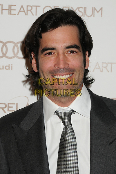 Carter Oosterhouse.5th Annual Art Of Elysium Heaven Gala held at Union Station, Los Angeles, California, USA, 14th January 2012..arrivals portrait headshot  grey gray tie white shirt smiling .CAP/ADM/BP.©Byron Purvis/AdMedia/Capital Pictures.