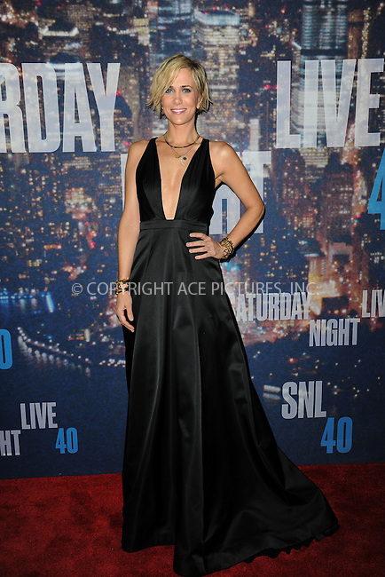 WWW.ACEPIXS.COM<br /> February 15, 2015 New York City<br /> <br /> Kristen Wiig walking the red carpet at the SNL 40th Anniversary Special at 30 Rockefeller Plaza on February 15, 2015 in New York City.<br /> <br /> Please byline: Kristin Callahan/AcePictures<br /> <br /> ACEPIXS.COM<br /> <br /> Tel: (646) 769 0430<br /> e-mail: info@acepixs.com<br /> web: http://www.acepixs.com