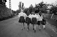 ROMANIA / Maramures / Valeni / July 2003..Girls on their way to the village church for a wedding ceremony...© Davin Ellicson / Anzenberger..