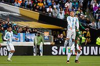 Seattle, WA - Tuesday June 14, 2016: Argentina midfielder Matias Kranevitter (5) goes up for a header during a Copa America Centenario Group D match between Argentina (ARG) and Bolivia (BOL) at CenturyLink Field