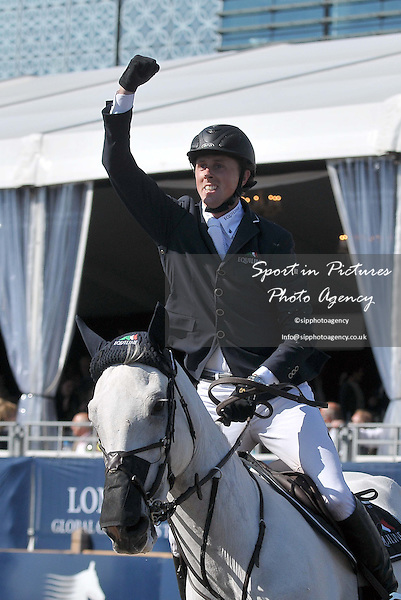 Ben Maher riding CELLA celebrates his win. CSI5* Grand Prix of London (1.60m). SHOW JUMPING - Longines Global Champions Tour. Olympic Park. Stratford. London. 08/06/2013. MANDATORY Credit Garry Bowden/SIP - NO UNAUTHORISED USE - 07837 394578