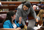 Nevada Assembly Democrats Irene Bustamante Adams, D-Las Vegas, left, and Olivia Diaz, D-North Las Vegas, work on the Assembly floor at the Legislative Building in Carson City, Nev., on Monday, April 22, 2013. .Photo by Cathleen Allison