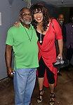 MIAMI, FL - MAY 29: Kym Whitley (R) and Carl Sams backstage at the 9th Annual Memorial Weekend Comedy Festival at James L Knight Center on May 29, 2016 in Miami, Florida. ( Photo by Johnny Louis / jlnphotography.com )