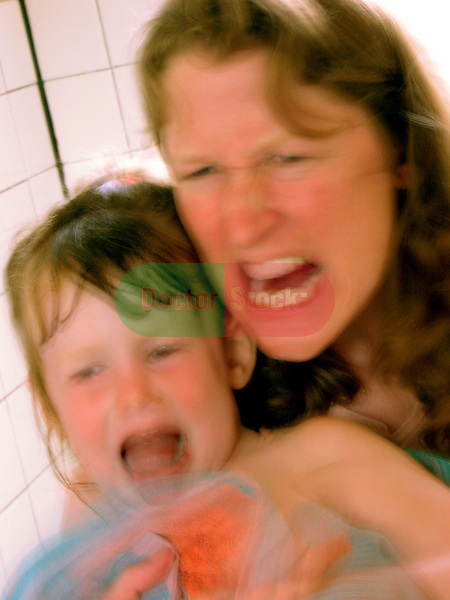 angry mother holding scared child while screaming in rage