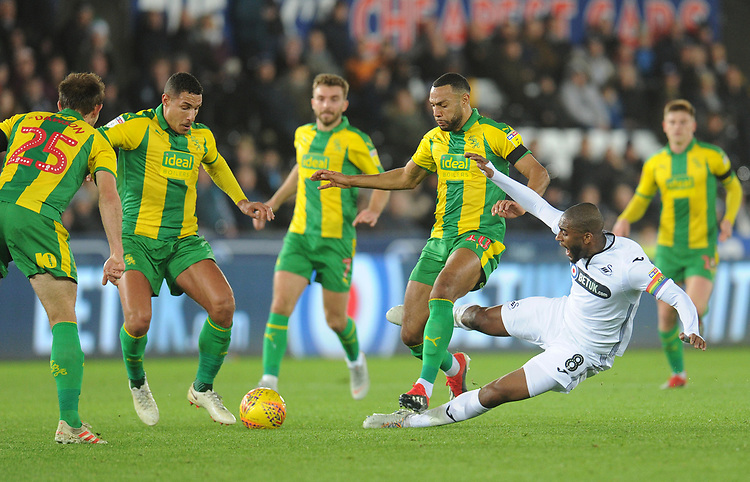 Swansea City's Leroy Fer is tackled by West Bromwich Albion's Matt Phillips<br /> <br /> Photographer Kevin Barnes/CameraSport<br /> <br /> The EFL Sky Bet Championship - Swansea City v West Bromwich Albion - Wednesday 28th November 2018 - Liberty Stadium - Swansea<br /> <br /> World Copyright &copy; 2018 CameraSport. All rights reserved. 43 Linden Ave. Countesthorpe. Leicester. England. LE8 5PG - Tel: +44 (0) 116 277 4147 - admin@camerasport.com - www.camerasport.com