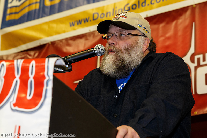 Race Marshal Mark Nordman announces the checkpoint of Galena as the Golden Clipboard award winner for the best checkpoint at the musher 's finishers banquet in Nome on Sunday March 16 after the 2014 Iditarod Sled Dog Race.<br /> <br /> PHOTO (c) BY JEFF SCHULTZ/IditarodPhotos.com -- REPRODUCTION PROHIBITED WITHOUT PERMISSION