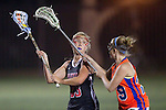 Santa Barbara, CA 02/18/12 - Audrey Benjamin (Chapman #23) and Christine Waterhouse (Florida #19) in action during the Chapman - Florida matchup at the 2012 Santa Barbara Shootout.  Florida defeated Chapman 12-11.