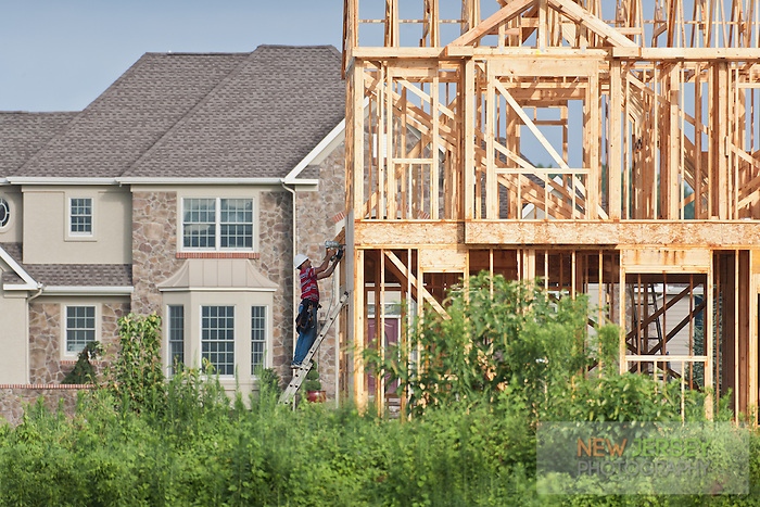 Man Working on New House Construction   New Jersey Stock Photography