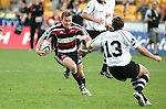 Kane Hancy wrong foots Justin Wilson during the Air New Zealand Cup rugby game between Counties Manukau & Hawkes Bay played at Mt Smart Stadium, 30th of September 2006. Hawkes Bay won 30 - 29.