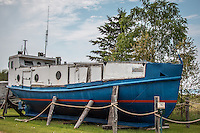 Old fishing boats on display in Cornucopia Wisconsin, a quaint village that is the Western Gateway to the Apostle Islands National Lakeshore on the South Shore of Lake Superior.