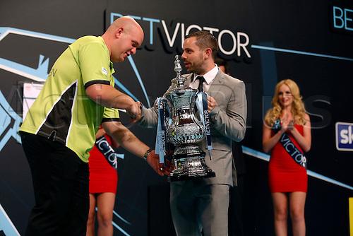 24.07.2016. Empress Ballroom, Blackpool, England. BetVictor World Matchplay Darts. Michael van Gerwen receives the winners trophy