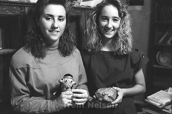 Christina Nelson and April Nelson holding a pop-out Indian and a rock with eyes (from Peter LeRoy's room) at Nana's house.<br />