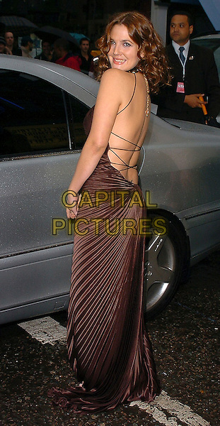 "DREW BARRYMORE.""The Perfect Catch"" - VIP screening at The Electric Cinema, London, W10..July 27th, 2005.full length brown silk satin dress pleated backless looking over shoulder.www.capitalpictures.com.sales@capitalpictures.com.©Capital Pictures"