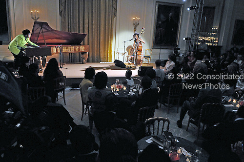 """Washington, D.C. - May 12, 2009 -- Esperanza Spalding, 24, a 2005 recipient of the Boston Jazz Society scholarship for outstanding musicianship, performs for United States President Barack Obama and first lady Michelle Obama during """"An Evening of Poetry, Music and the Spoken Word in the East Room of the White House in Washington, DC on Tuesday, May 12, 2009..Credit: Ron Sachs / Pool via CNP"""