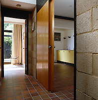 An original sliding wooden door leads from the tiled hall into the open-plan kitchen/living and dining area