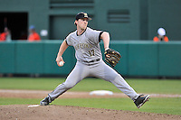 Pitcher Grant Byers (17) of the Wofford College Terriers delivers a pitch in a game against the Clemson University Tigers on Tuesday, March 1, 2016, at Doug Kingsmore Stadium in Clemson, South Carolina. Clemson won, 7-0. (Tom Priddy/Four Seam Images)