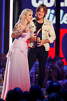 NASHVILLE, TN - JUNE 5: (L-R) Julia Michaels and Keith Urban accept an award on the 2019 CMT Music Awards at Bridgestone Arena on June 5, 2019 in Nashville, Tennessee. (Photo by Frederick Breedon/PictureGroup)
