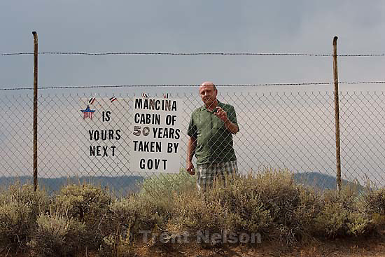 Scofield - People who have owned property and houses along the shores of the Scofield Reservoir for over 50 years are now being told by the federal government that they don't really own those places and must leave. The Mancina family could lose the cabin that's been in their family for over fifty years. Paul Mancina stnads by a sign on the entry to his familiy's property, Thursday, September 3 2009.