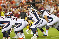 Landover, MD - August 24, 2018: Denver Broncos quarterback Case Keenum (4) calls an audible during the preseason game between Denver Broncos and Washington Redskins at FedEx Field in Landover, MD.   (Photo by Elliott Brown/Media Images International)