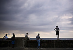 Cubans hang out along the Malecon that borders northern Havana and the Gulf of Mexico, in Havana, Cuba, on Sunday, April 27, 2008.