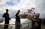 """This October 29, 2008 file photo shows Italian peace activist Vittorio Arrigoni at the port in Gaza City celebrating the arrival of the 20-metre (65-foot) ship """"Dignity"""" that departed from Cyprus the previous day to protest against the Israeli sanctions imposed after the Islamist Hamas movement seized the Gaza Strip in June 2007. A Salafist group of radical Islamists killed Italian activist Vittorio Arrigoni after kidnapping him in Gaza, a Hamas security official said Friday, April 15, 2011. """"The Italian was killed by suffocation and his body was found in a street of the city of Gaza,"""" a spokesman for the Islamist movement which controls the Gaza Strip reported. Two suspected kidnappers were arrested and security officials are looking for accomplices. Photo by Ashraf Amra"""