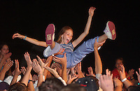 A fan crowd surfs during Better Than Ezra during the Saturday night show at SpringFest 2002.