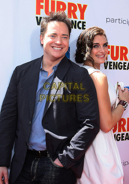 "BRENDAN FRASER & BROOKE SHIELDS.Los Angeles Premiere Of Summit Entertainment's ""Furry Vengeance"" held at The Mann Bruin Theatre, Westwood, California, USA, 18th April 2010..half length navy blue shirt jacket smiling hands in pockets white dress back to back sleeveless .CAP/ADM/TC.©T. Conrad/AdMedia/Capital Pictures."