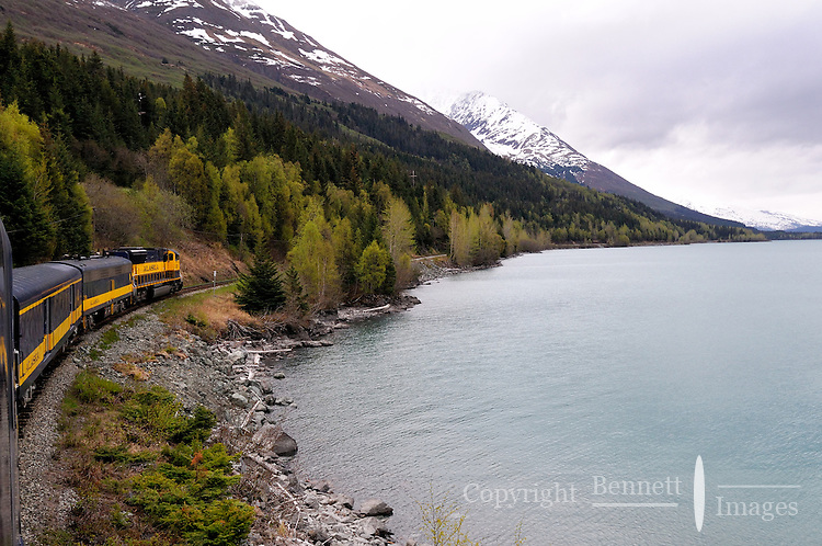 The Alaska Railroad's Coastal Classic train runs past Kenai Lake on its way to Seward.