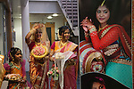 Hindu Coming of Age celebration party London Uk The display photograph is of the young woman. She is on the left with hand raised, with her mother. She is 16yrs old. Mitcham south London Uk They  are welcoming guests to the very big Ritusuddhi, also called as Ritu Kala Samskara party.