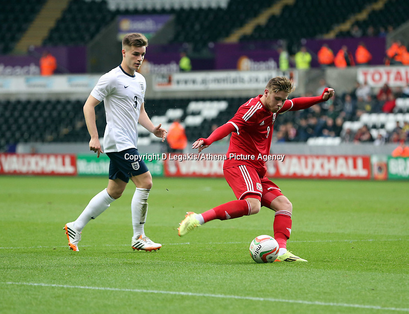 Pictured: Wes Burns of Wales (R) takes a shot at goal. Monday 19 May 2014<br /> Re: UEFA Euro Under-21 Qualifier, Wales v England at the Liberty Stadium, Swansea, south Wales, United Kingdom