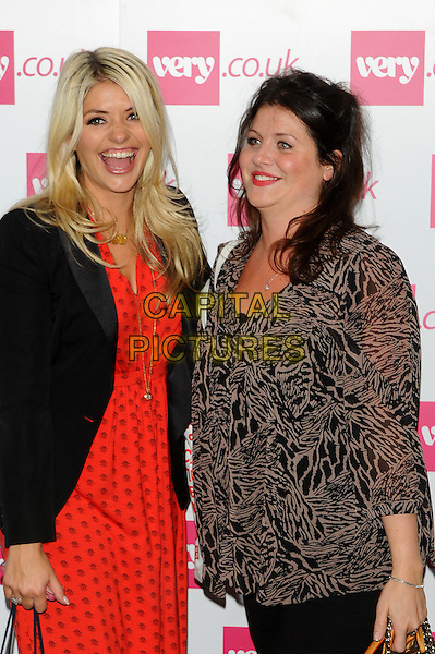 Holly & Kelly Willoughby.The Very.co.uk Fashion Preview for Spring and Summer 2012, Mercer Studios, London, England..September 20th, 2011.half length dress blazer jacket black orange dress print side beige grey gray sheer blouse sisters siblings family mouth open smiling.CAP/CJ.©Chris Joseph/Capital Pictures.