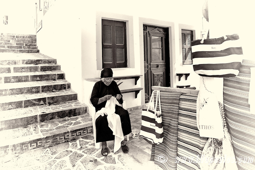 An old woman knit traditional handcrafts at the village Olympos in Karpathos, Greece