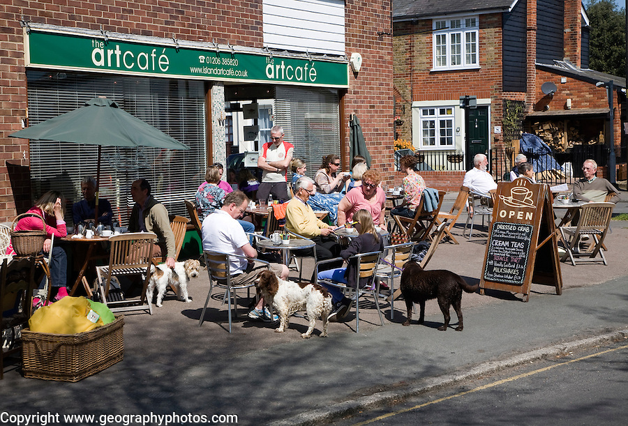 People sitting outside the art cafe, West Mersea village, Mersea Island, Essex, England