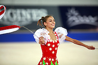 September 23, 2007; Patras, Greece;   Evgenia Kanaeva of Russia expresses with 2-ribbons during gala exhibition at 2007 World Championships Patras.   Evgenia helped Russia win the team gold earlier at Patras. Photo by Tom Theobald.