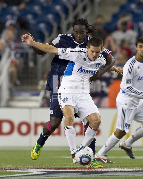 San Jose Earthquakes midfielder Sam Cronin (4) attempts to control the ball as New England Revolution midfielder Shalrie Joseph (21) pressures. In a Major League Soccer (MLS) match, the San Jose Earthquakes defeated the New England Revolution, 2-1, at Gillette Stadium on October 8, 2011.