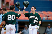 Dartmouth Big Green designated hitter Matt MacDowell #29 is greeted by Nick Lombardi #20 after hitting his first collegiate home run during a game against the Long Island Blackbirds at Chain of Lakes Stadium on March 17, 2013 in Winter Haven, Florida.  Dartmouth defeated Long Island 11-4.  (Mike Janes/Four Seam Images)