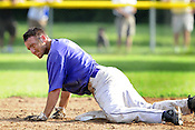 Cudahy baserunner Todd Szymuszkiewicz gets up after sliding into second base in the fifth inning during the sectional semifinal game against Franklin on Saturday, July 24, 2010 at Sheridan Park. Szymuszkiewicz was Cudahy's top hitter in the game. Ernie Mastroianni photo.